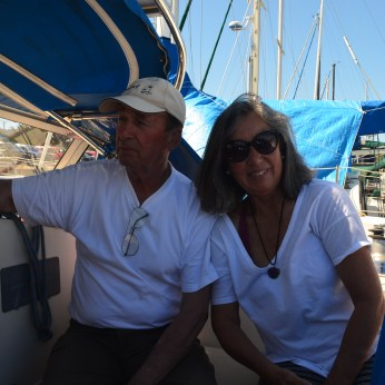 A happy couple sharing their cruising story.