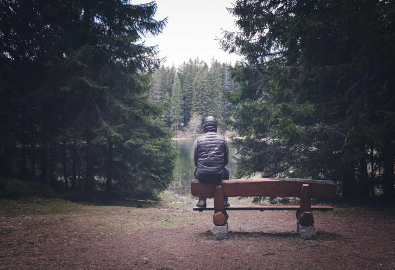 Sad man sitting alone on bench