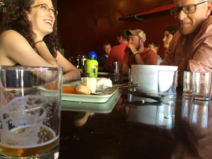 Local patrons enjoying some of Williams' latest creations. Photo Courtesy of Flying Lion Brewing.