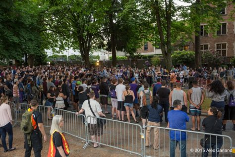 Students swarm the University of Washington's Greek Row to protest the perceived conduct of the school's fraternities.