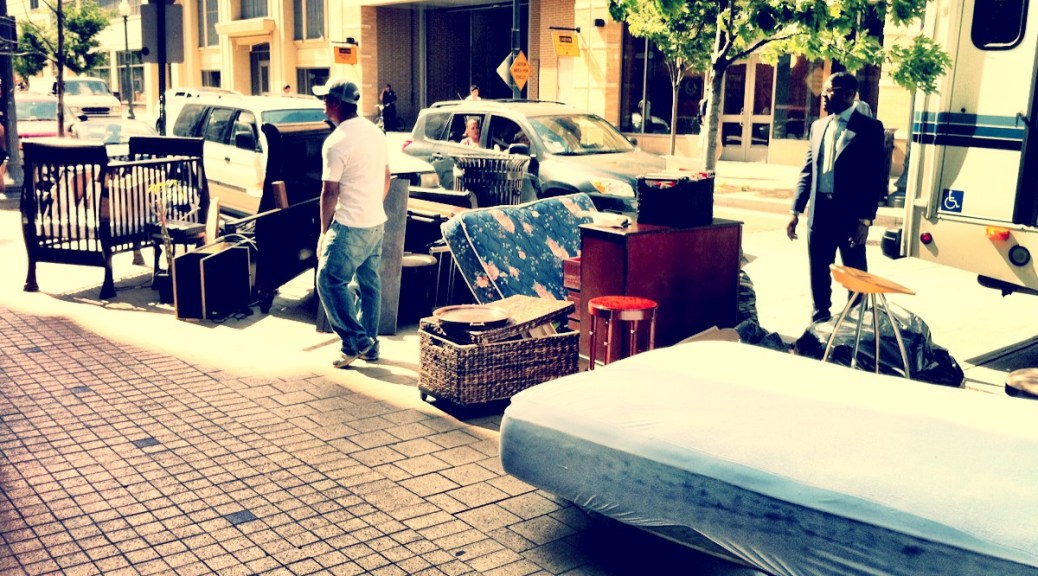Household furniture and belongings out on the sidewalk