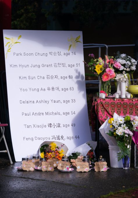 A handmade sign shows the names, ages and translations of the spa workers killed in Atlanta on March 16th. (Photo: Chloe Collyer)