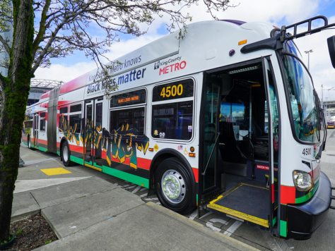 A 60-foot long Metro buses have been wrapped with Black Lives Matter artwork by artist and transit operator Robert L. Horton.