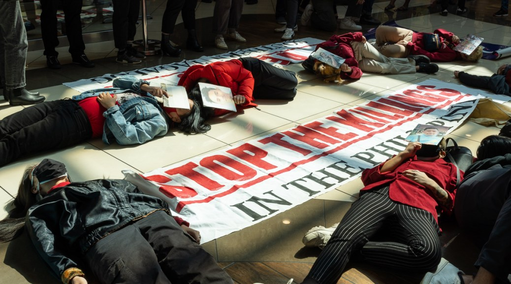 On Sunday, April 11, Filipino American activists lay on the ground holding cut-outs of nine Filipino activists that were killed last March in what has been called Bloody Sunday.