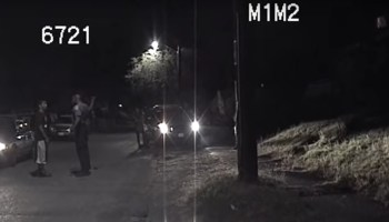 Screenshot of Seattle Police Department (SPD) body cam video of an incident in which an officer punched a woman in handcuffs during an arrest in 2014.