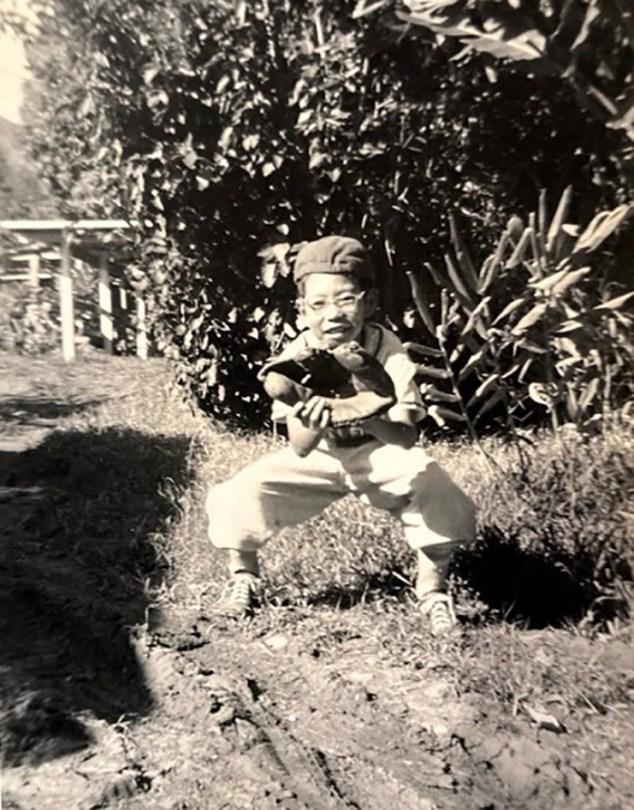 A black and white photo of a young Bob Shimabukuro as a catcher.