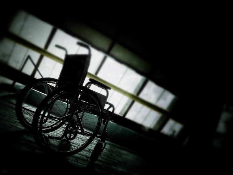 photo of wheelchair in darkened room