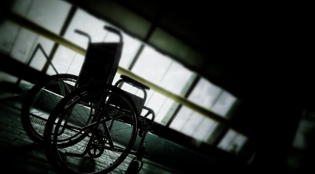 photo of wheelchair in darkened room