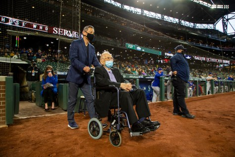Gene Moy and son Corey (in blue jacket) at Moy's recognition during Salute To Those Who Serve. The recognition was part of a pregame presentation, Asian American Pacific Islander Heritage Night, at last Thursday's Mariners home game. (Photo by Ben VanHouten/Seattle Mariners.)