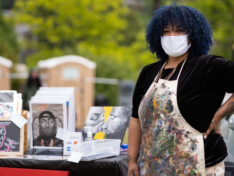 Monie Love, a local artist, sold prints and paintings during the event. She is new to the Seattle area and is hoping to connect with more artists in the community.