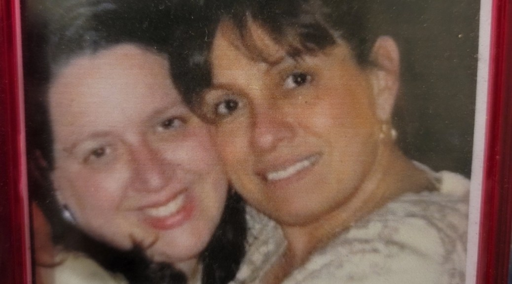 Photograph of a Latina mother and daughter.