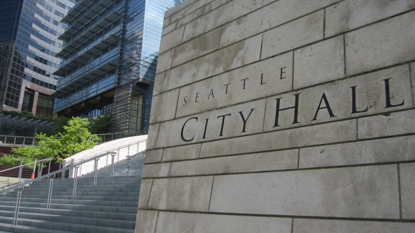 Photo of Seattle City Hall name on brick wall