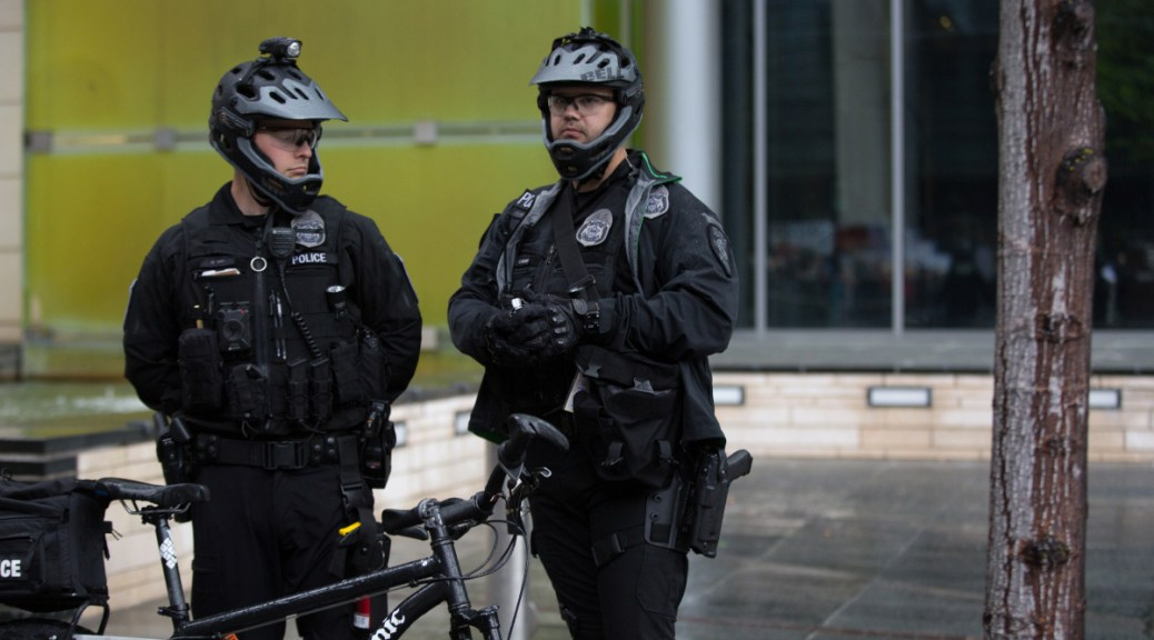 Photo of two Seattle Police Department bike officers.