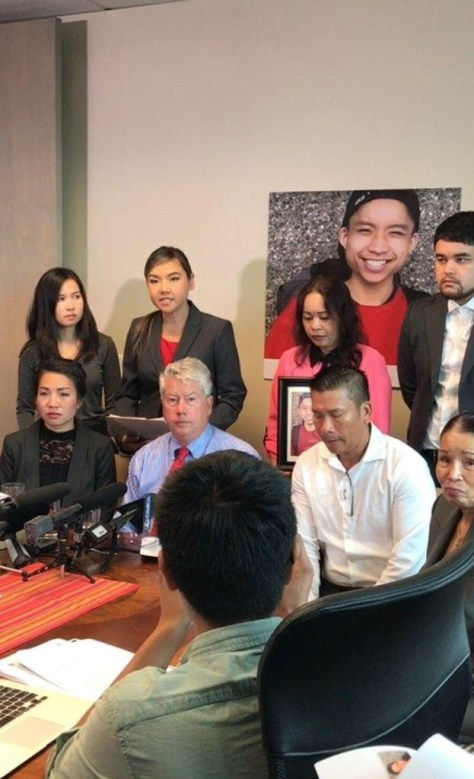 Photo of Tommy Le's family with their legal team at a press conference in 2017.