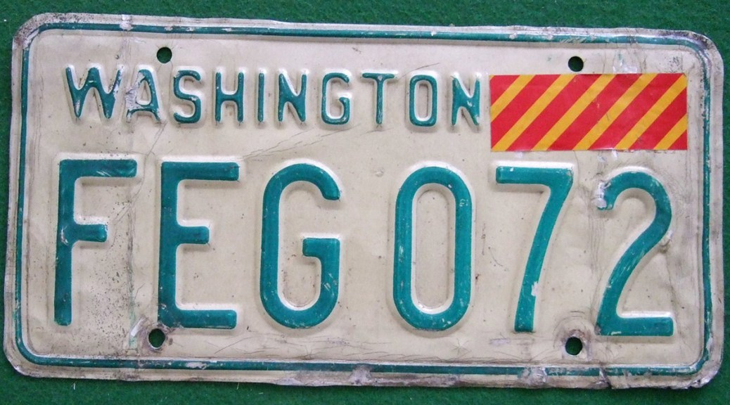 Photo of a Washington state driver's license with a red and yellow sticker in the upper-righthand corner.