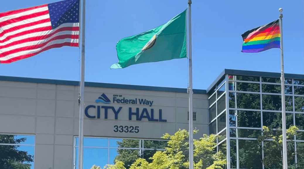 US flag, Washington State flag, and Pride flag flying in front of Federal Way City Hall. Photo: Allison Fine