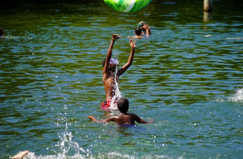 Several boys play in Lake Washington on a hot June afternoon. (Photo: Susan Fried)