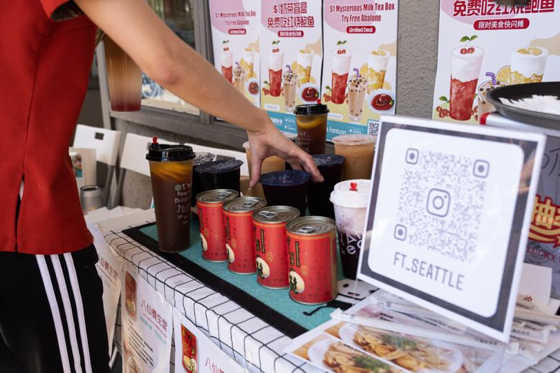 The Fantuan Delivery Seattle table sold cold beverages for event attendees to help brace the heat.
