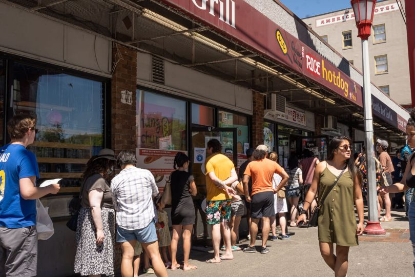 Photo of event attendees queued in front of Chung Chun Rice Dog in Seattle's Chinatown-International District.