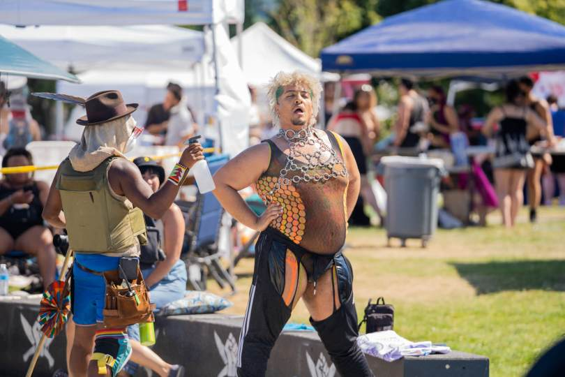 Local burlesque performer Ganesha gets sprayed down with water during their performance in the first half of Taking B(l)ack Pride.