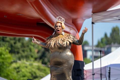 Seattle drag performer Beyonce St. James defies the heat in a floor length sequin dress.