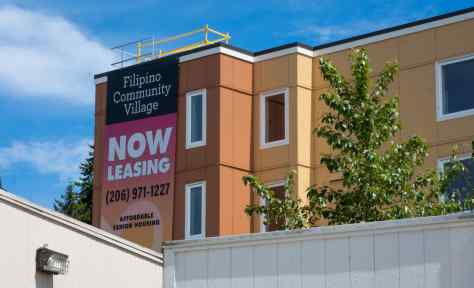 Photo of exterior of the new Filipino Community Village apartment complex.