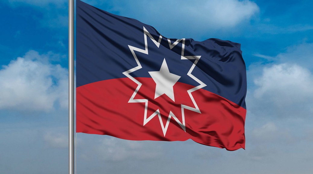 Photo of the Juneteenth flag (blue and red with a white star).