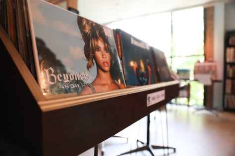 Photo of the vinyl selection inside Empire Roasters & Records, focusing on Beyonce's B-Day album.