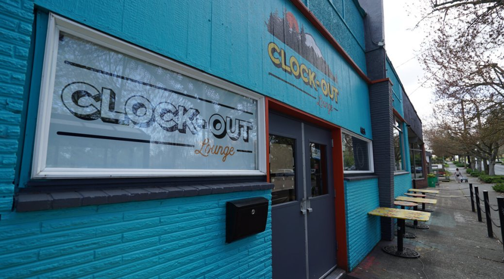 Photo of the bright-blue exterior of the Clock-Out Lounge.