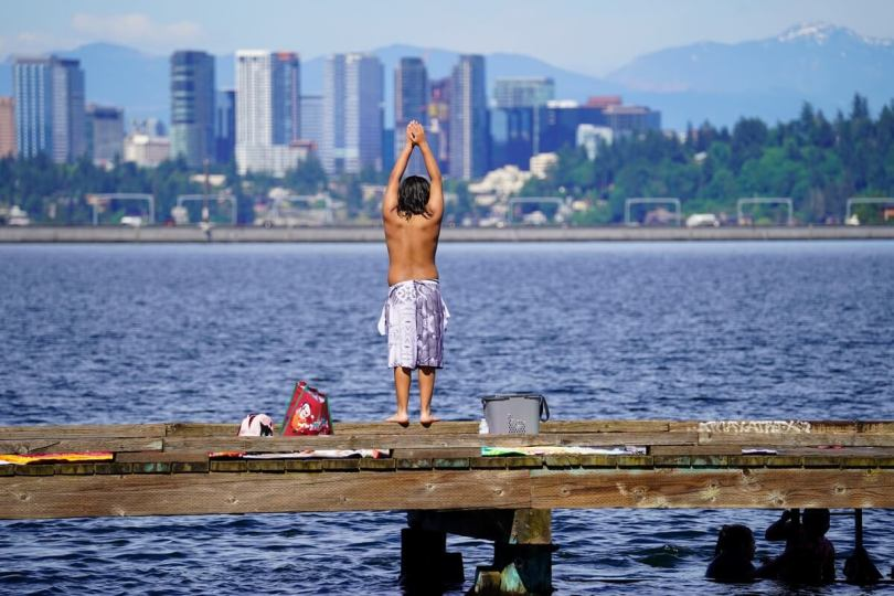 photo of boy on dock preparing to dive into Lake Washington