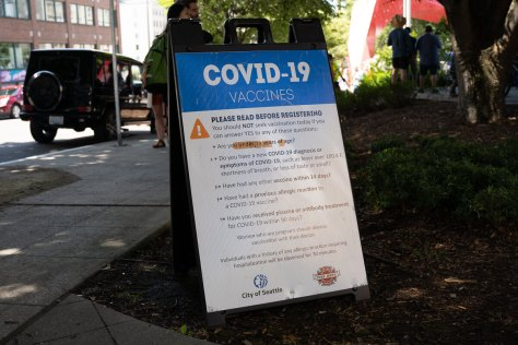 Photo of COVID-19 Vaccination sign in Hing Hay Park.