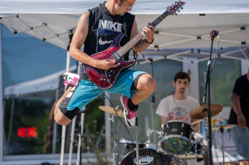 Eric Anthony Suza Ponce does a high jump while performing with his band Vibes.
