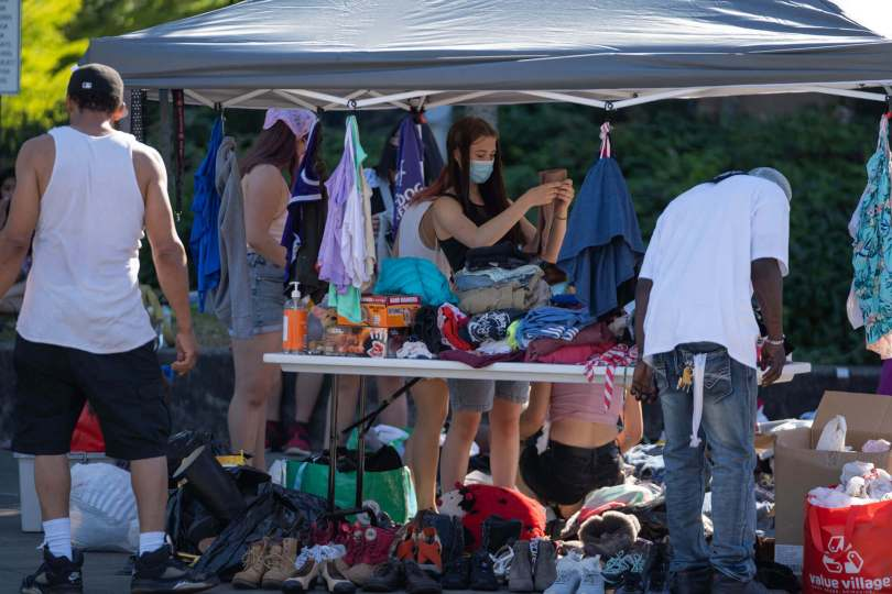 Youth volunteers help distribute free clothing to community members outside Rainier Beach Community Center.