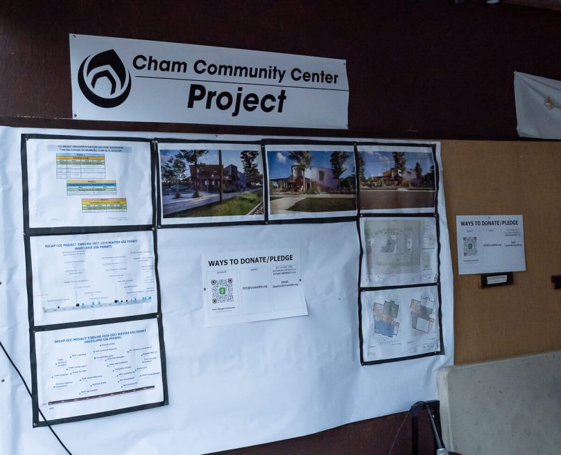 Photo of a poster outlining the Cham Community Center project.