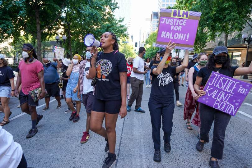Ashley Paynter, @Decolonizingsci, helps lead a march through downtown Seattle following the #BreatheforKaloni rally on Saturday, July 24, 2021, at Westlake Park.