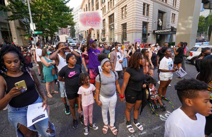 A crowd led by Kaloni Bolton's extended family marches through downtown Seattle following the #BreatheforKaloni rally on Saturday, July 24, 2021, at Westlake Park.