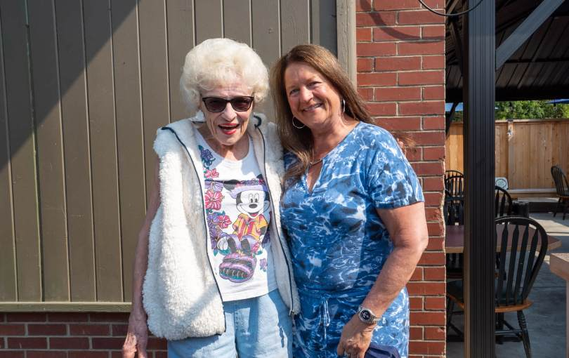 Beachcomber Sports Bar and Grill regular Pat B. and owner Judy step outside into the outdoor patio