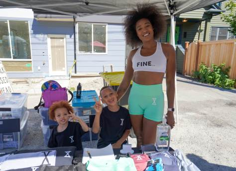 Pasqualina Tuggle, owner of Fine Gang Apparel, and her sons Prince, 7, and Saint, 3, were one of the vendors selling their wares at the Reunion on Union.