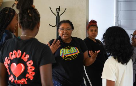 Sydney B.Coleman talks with some of the young people about taking care of their voices during the run of the musical.