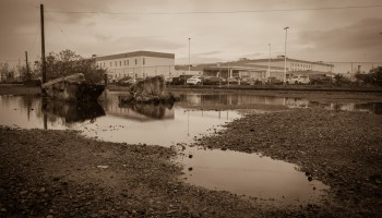 Sepia-toned photo of the exterior of Northwest ICE Processing Center.