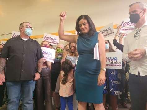 Council President Lorena Gonzalez raises a fist during her speech