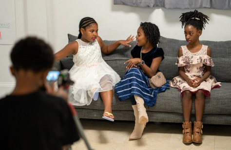 Young actors Samaya Jeffries, 9, Ny'asia Anderson, 10, and Arianna Davis, 10, perform in a film they helped write during the five-day Reel Youth Film Camp August 16–20 at the Rainier Arts Center. (photo: Susan Fried)