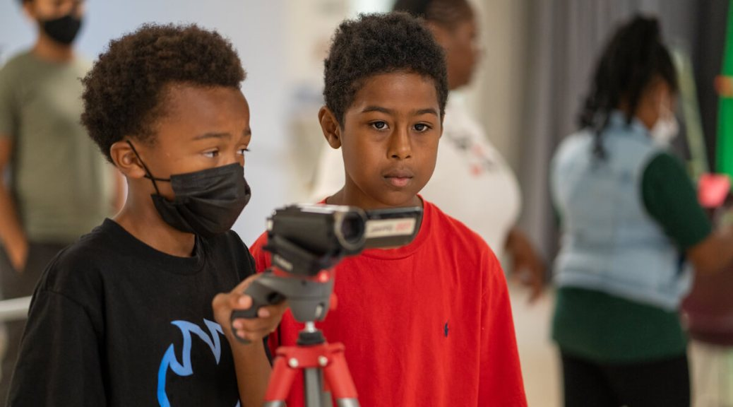 Students Terry Hill, 11, (left) and Ezekiel Rapier, 11, (right) position the camera while filming a movie they helped write during the 5 day Reel Youth Film Camp August 16- 20 at the Rainier Arts Center. (photo: Susan Fried)