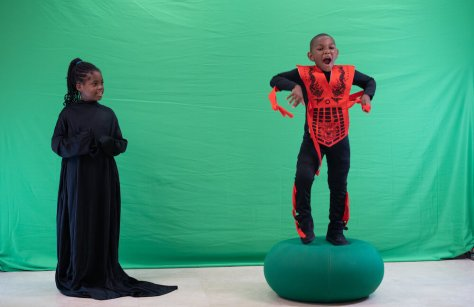 Kingston McCants, 7, practices being a dragon before, he's filmed in front of a green screen during the 5 day Reel Youth Film Camp August 16- 20 at the Rainier Arts Center. (photo: Susan Fried)