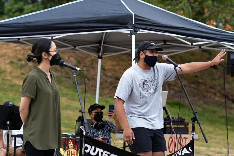 Local artist and community organizer Enrico Abadesco (right) performs one of his songs.