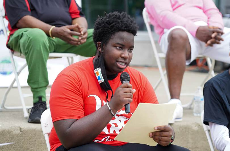 Lincoln Wilmore, 16, talks during a panel discussion about gun violence