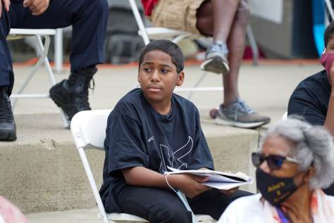 Jamari Wilmore, 12, who works with the youth organization We Are Amazing listens to a discussion about gun violence