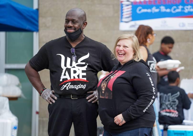 Larry Wilmore and Alicia Dassa share a laugh in front of the Rainier Beach Community Center.