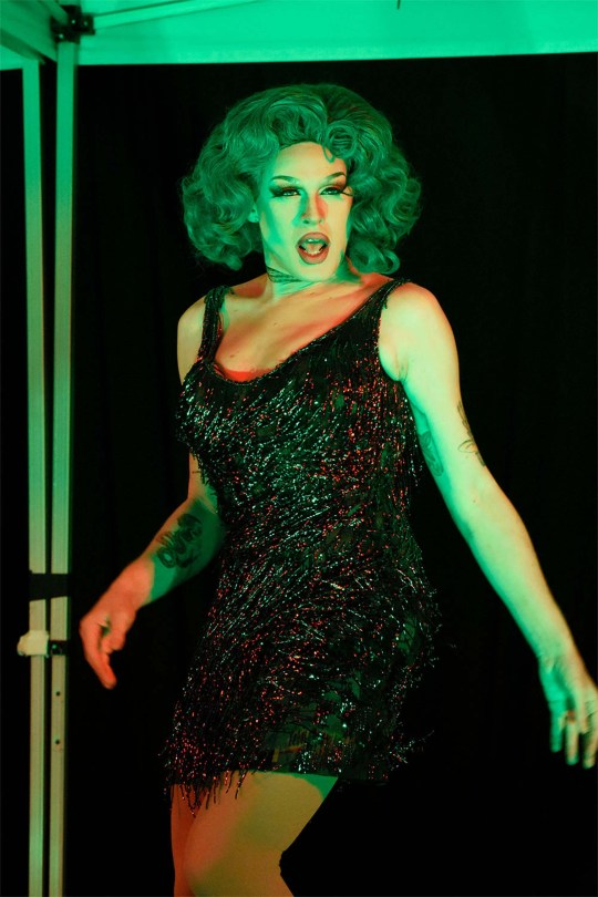 Photo depicting Betty Wetter in a black sequined dress performing.