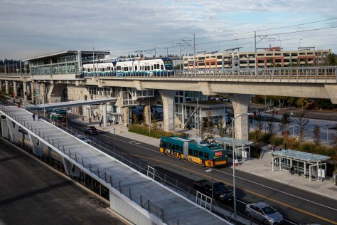 Photo depicting the above-ground Northgate Station with a light rail car pulling into it.